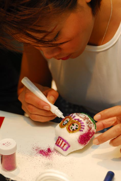 Working on our skulls, image by Mihono Sato