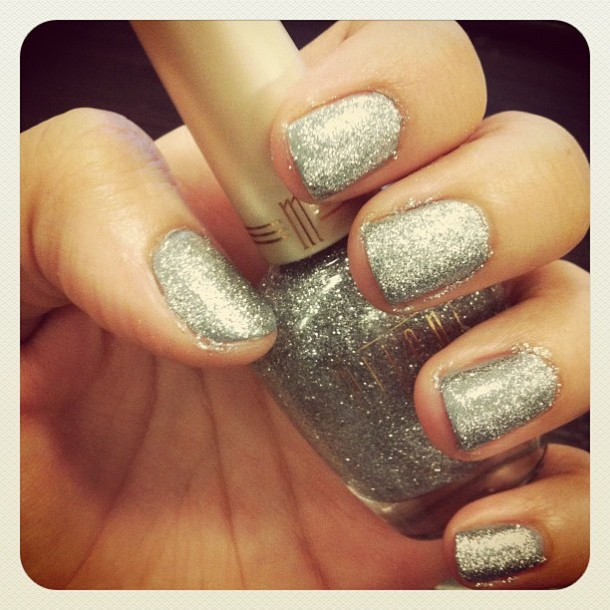 silver glitter over grey varnish