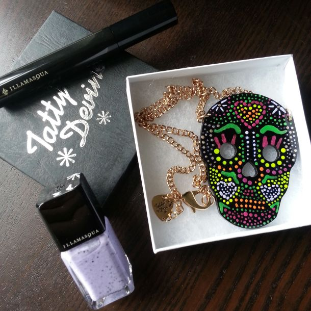 Illamasqua nail polish and mascara, Tatty Devine sugar skull necklace.