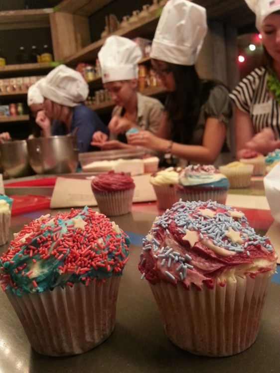 Decorating cupcakes in red, white and blue, of course! My winning cupcake is on the right.