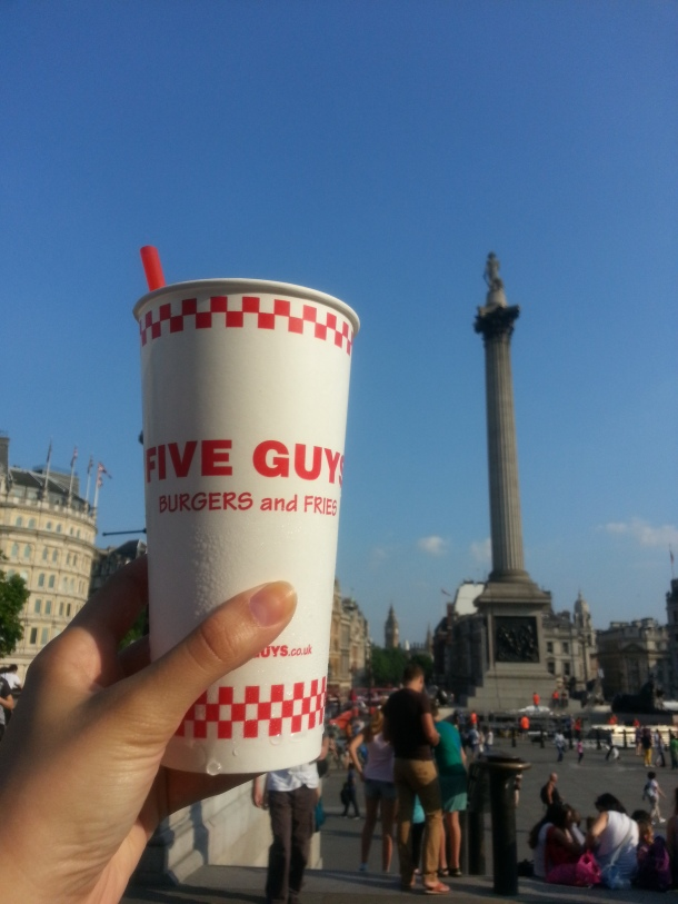Five Guys cup in Trafalgar Square.