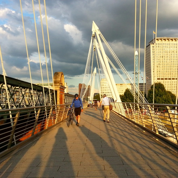embankment bridge by southbank in london at sunset