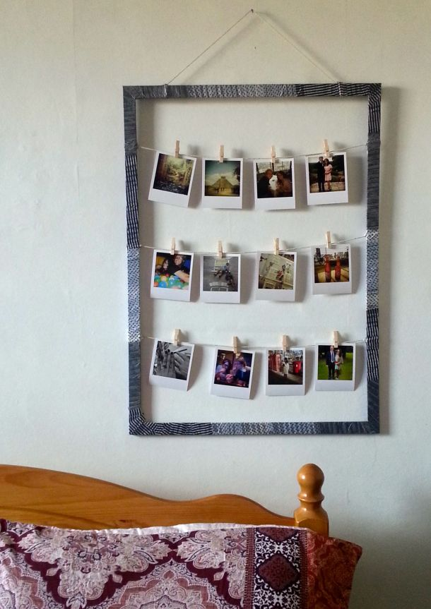DIY frame with patterned tape to display polaroid style pictures on wall in bedroom