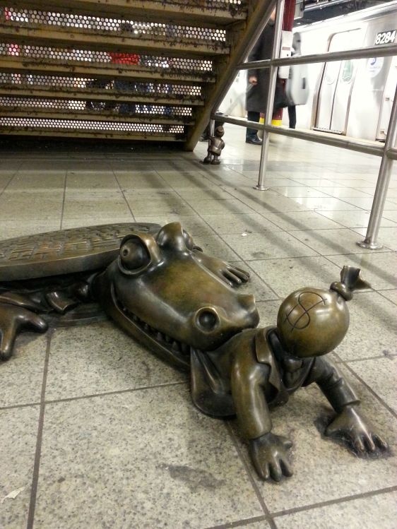 Spotted in the NYC metro! A 'Life Underground' bronze sculpture of a sewer alligator.