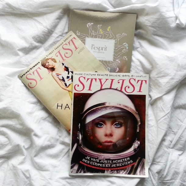 Paris Airbnb weekend travel saturday with magazines in bed