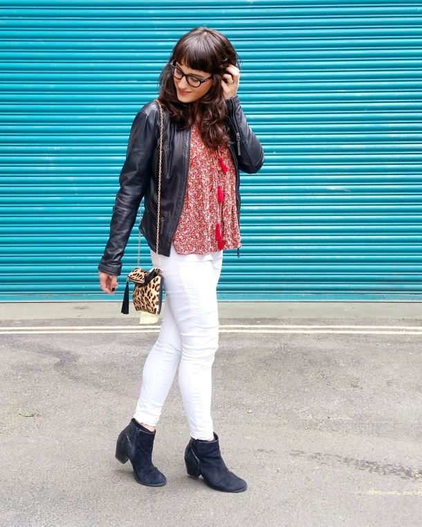 Call Me Katie - wearing white jeans, black leather jacket, heeled boots and red pompom tunic for weekend look 1