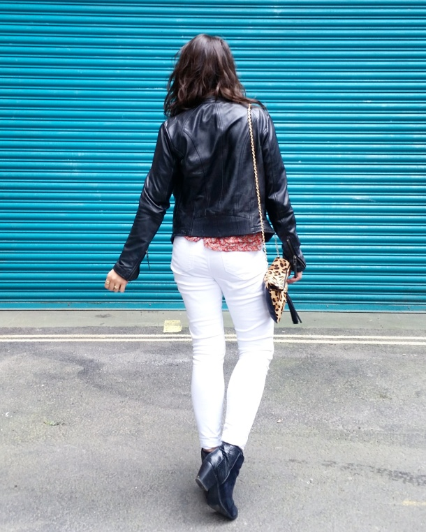 Call Me Katie - wearing white jeans, black leather jacket, heeled boots and red pompom tunic for weekend look 3