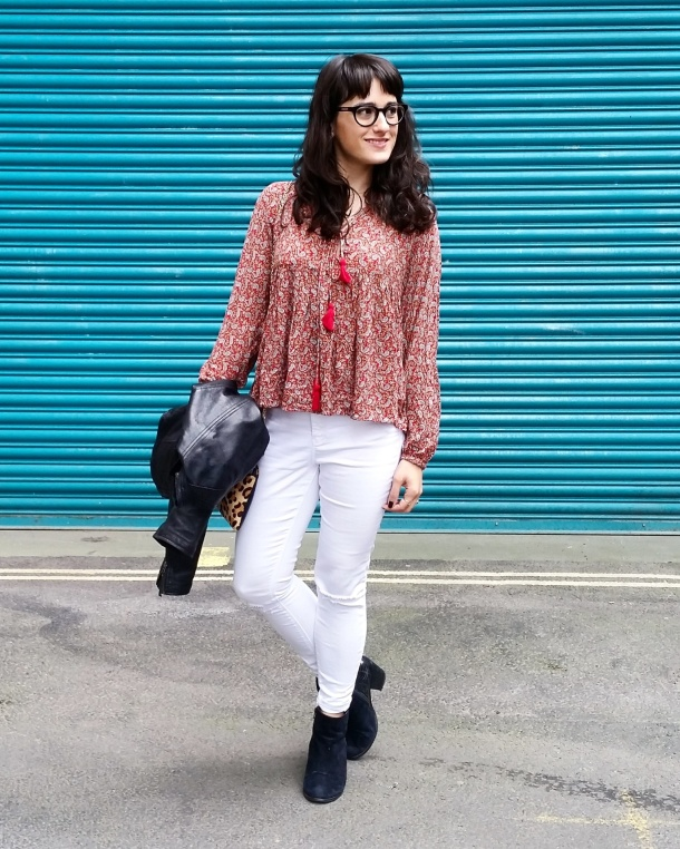 Call Me Katie - wearing white jeans, black leather jacket, heeled boots and red pompom tunic for weekend look 4