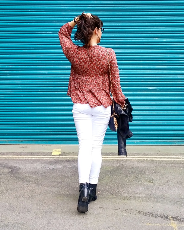 Call Me Katie - wearing white jeans, black leather jacket, heeled boots and red pompom tunic for weekend look 6